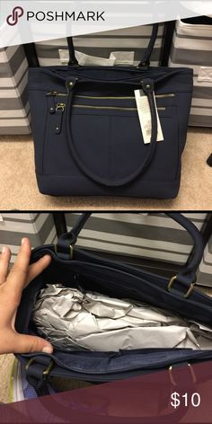 Navy shoulder bag Navy timeless collection bag by Merona. Suede leather feel. Two zipper pockets on the front Merona Bags Shoulder Bags