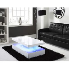 Looking for a show stopping centre piece? Our TIFFANY coffee table offers a unique design with discreet LED lighting strips and a high gloss finish. Items featured: High Gloss White Coffee Table with LED lighting - Tiffany Range White Gloss Coffee Table, Mirrored Coffee Tables, White Coffee, Living Room Styles, Living Room Modern, Living Rooms, Contemporary Coffee Table, Modern Coffee Tables, Center Table Living Room