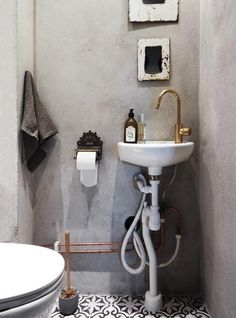 transform rental bathroom with grey and black and white tiles