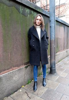 wool coat and white polo from Filippa K, jeans from Frame Denim, boots from Acne Studios.