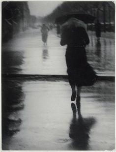 Brassaï - Passers-by in the rain, 1935.