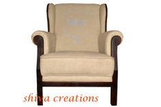 Single sitter wooden sofa with linen fabric.