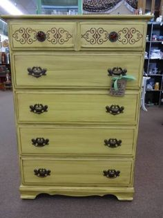 """$139 - Shabby chic 5 drawer tallboy painted sweet corn yellow with stenciled details on top drawer, newer and old hardware - lightly distressed and finished in a tinted wax. 42"""" tall x 29 1/2"""" wide x 18"""" deep. ***** In Booth A8 at Main Street Antique Mall 7260 E Main St (east of Power RD on MAIN STREET) Mesa Az 85207 **** Open 7 days a week 10:00AM-5:30PM **** Call for more information 480 924 1122 **** We Accept cash, debit, VISA, Mastercard, Discover or American Express"""