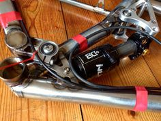 There's been some interesting goings on at Swarf Cycles. We take a peek. Tumblr Car, Mtb Parts, Air Shocks, Up To Something, Full Suspension, Electrical Tape, Mountain Biking, Things That Bounce, Bicycles