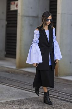 It's no surprise Aussie brand Ellery was a street style favorite in Sydney. Just look at those sleeves!Ellery top. #refinery29 http://www.refinery29.com/2016/05/111596/sydney-fashion-week-resort-2016-street-style-pictures#slide-2