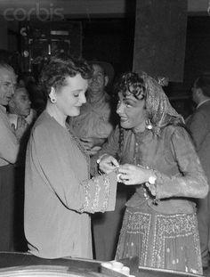 "Mary Astor visits Marlene Dietrich on the set of ""Golden Earrings"" in 1948"