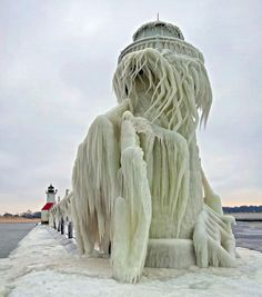 St Joseph Lighthouse, Lake Michigan after storm This is the St. Joseph Lighthouse on Lake Michigan. Today, it is encased in ice as the Midwest was hit with wind chills that reached degrees. Lago Michigan, Michigan Usa, St Joseph, Luis Gonzaga, Fuerza Natural, Art Environnemental, Ice Storm, Storm Lake, Pin Up Girls