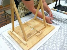 Making an ironing board from a TV tray.