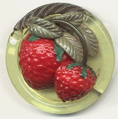 I wonder what the garment was that was lucky enough to have this vintage celluloid strawberry button.