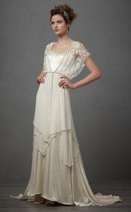 Evoking a Bygone Era. I've never seen a wedding dress I was particularly drawn to until this one. I should've lived in the 20's.
