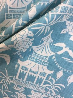 Our moon pagoda fabric brings an exotic tropical feel to your home and can be used to make beautiful pillows or drapery! The blue and white print has a light beach vibe, perfect for brightening up your space. Our talented team would be happy to help you with your home decor project!