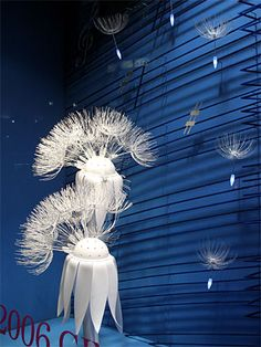 This would be amazing if the seedpods floating away were also votifs Window Display Design, Store Window Displays, Retail Windows, Store Windows, Deco Nature, Retail Store Design, Visual Display, Through The Looking Glass, Paper Flowers