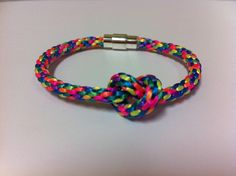 This is an eight-cord kumihimo braid bracelet made with 1mm satin cord in rainbow neon color mix with a magnetic twist clasp.  A knot has been placed on the top for luck.These bracelets can be custom ordered based on cord size, cord color, clasp type and added charms.
