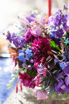 Purple Blue and Fuchsia Flower Arrangement | event design, concept, coordination, and cake design by http://www.chictochicweddings.com/ | photography by http://www.christinechoi.com/blog | floral design by http://www.theflowerlab.com/