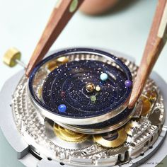 Van Cleef & Arpels Midnight Planétarium Poetic Complication timepiece, Poetic Complications™ collection #PoeticAstronomy #SIHH2014 Aventurine discs assembling.