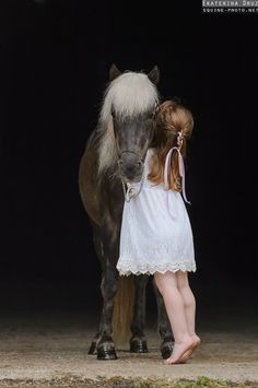 Kids and horses, cute little girl on her tip toes in pretty white dress, pink ribbons in her hair hugging her cute little dapple grey pony with full white mane, adorable! Please also visit www.JustForYouPropheticArt.com for colorful inspirational art. Thank you so much! Blessings!