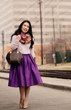 Purple skirt and colorful scarf with neutral top and heels