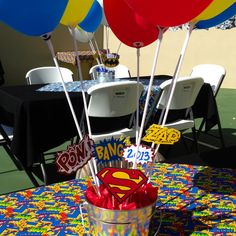 Balloon Centerpieces using balloon sticks (use a can of soup to tape the ends to and hide in a bucket with tissue)