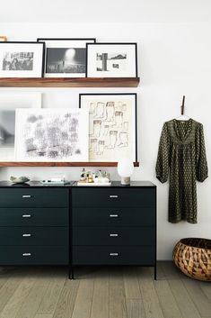 black and white bedroom - art ledge over the dresser