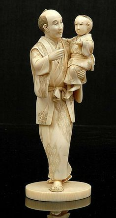 Japanese ivory okimono of a man holding a boy Meiji period 1868 - 1912 signed Toshi Hide both figures realistically modelled with stained garments signed within lacquer plaque to base. Height 18 cm.