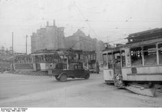 Destroyed tram cars being used as roadblocks in Berlin, Germany, Mar 1945. Note the Framo three-wheeled delivery truck passing through.