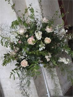 For the Church, a pretty stand arrangement of peach, white and pink flowers.