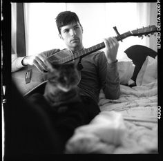 Seth Avett & a cat!    http://www.theavettbrothers.com/wp-content/blogs.dir/25/files/official/echo_1-11004.jpg