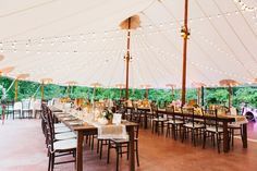Sperry Tent with farm tables, burlap and lace runners and bistro lights at a Willowdale Estate wedding. Venue: Willowdale Estate - willowdaleestate.com Photography: Erin McGinn - erinmcginn.com Read More: http://www.stylemepretty.com/2014/12/29/rustic-elegance-at-willowdale-estate/