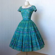 vintage 1950's dress  ...dior inspired GIGI YOUNG new york floral chiffon full skirt cocktail party pin-up dress with tulle underskirt. $260.00, via Etsy.