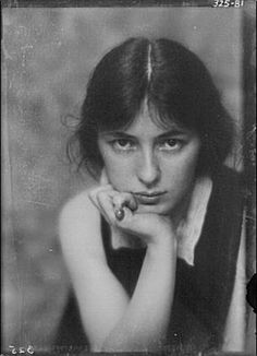 Evelyn Nesbit. Sometimes even seemingly plain faces can be incredibly interesting. The girl in the red velvet swing.