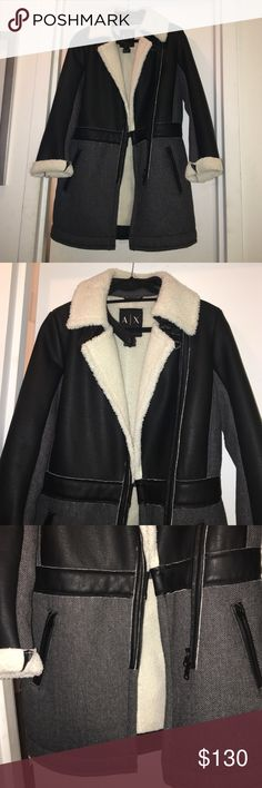 Armani Exchange coat Armani Exchange shearling coat. Brand new. Never worn. Black and grey with white/cream shearling. Zipper detail. Motorcycle style. Up to knee length. So cozy and warm. 53% polyester. 31% acrylic. 5% cotton. 5% viscose. 3% polyamide. 3% wool. A/X Armani Exchange Jackets & Coats