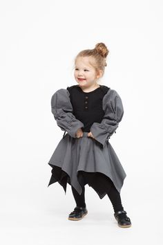 Sustainable Kids Fashion | 2 layer tulle skirt made from organic cotton with elasticated waist and a voluminous underlining. Works great over leggings! Colour: copper and grey/striped. Explore our eco friendly clothing for boys and girls at https://www.infantiumvictoria.com/collections/urgothic-collection/products/stripe-skirt | Vegan Baby Clothes