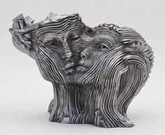 SCULPTURES MADE FROM STAINLESS STEEL RIBBONS BY GIL BRUVEL .