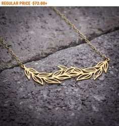 CYBER MONDAY SALE!!!  Leaf necklace, leaves necklace, leaf branch necklace, leaf pendant, gift for her, nature necklace, unique necklace, goldfilled necklace.  _________________________________________________________________________________________    LeaF necklace, delicate gold plated leaf branch pendant greek/grecian style necklace. large Leaves pendant.  Stunning, simple and beautiful gold leaves branch pendant hangs on delicate 18K gold filled chain.    Comes in a beautiful recycled…