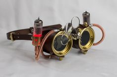 Leather Steampunk Goggles - Powered Ocular Enhancers - Brown with Red LED Vacuum Tubes by CraftedSteampunk on Etsy https://www.etsy.com/listing/218940852/leather-steampunk-goggles-powered-ocular