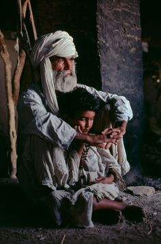 'Father and son in Helmand Province', 1980. | 24 Striking Pictures Of Afghanistan By Photojournalist Steve McCurry