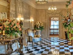 Tobin Clarke Estate checkerboard flooring, French molding and brasserie with elegant chandeliers and soft lighting