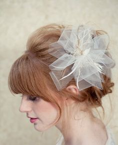 18 of the Prettiest Wedding Veils and Headpieces to Walk Down the Aisle In: This Melinda Rose Design bridal mini hat veil ($175) emotes a sweet, throwback vibe for the art-deco bride. : We love the soft tulle pleats on this LoBoheme bridal fascinator ($128).