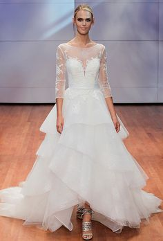Brides: Alyne by Rita Vinieris. Shimmering tulle high-low ball gown with…