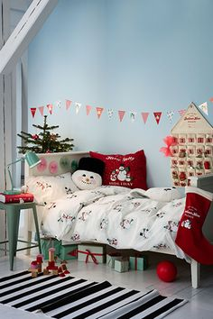 The children were nestled all snug in their beds, while holiday décor danced near their heads. Click through to deck the halls with H&M Home!