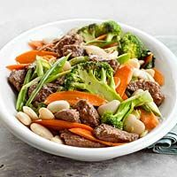 Searching for a quick and #healthy dinner tonight? Try this Beef and Bean Stir-Fry #recipe stir-fry! Pair John Soules Foods Angus Beef Steak with broccoli florets, carrots, onions, and beans in a tangy orange-soy dressing.