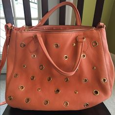 J Crew studded Coral Bag Super cute springy bag, with gold stud hardware- can be worn as a cross body or carried with top handles. Great sized. I have in two other colors or I'd be hanging onto it! J. Crew Bags Crossbody Bags