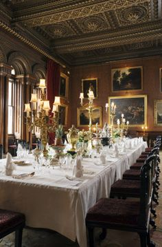 The Dining Room at Penrhyn Castle, Gwynedd, Wales. The dining table is laid with the Thomas Heming flatware, 1771-1780, and racing trophies.