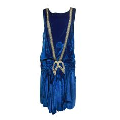 """1920s dress in cobalt blue silk velvet: dropped waist, tank style bodice and heavy gathering at front center. embellished with a deep """"V"""" of beading and rhinestones on front."""