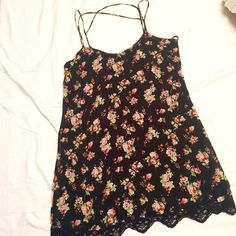 Floral Urban Outfitters Dress!  Gorgeous dress from Urban Outfitters - Pins and Needles brand. Size M. This dress is so cool - the straps cross in the back and the bottom edge has a black lace trim! Black dress with red/pink/green flower design. Urban Outfitters Dresses Mini
