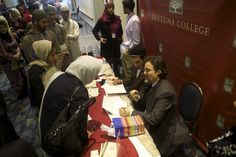 Shayk Hamza speaking with ISNA attendees during a book signing event.