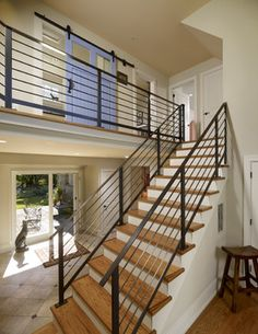 Newel Post and railings. Wires instead of balusters is probably ...