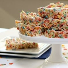 Fruity Pebble Krispies Treats....part Rice Krispies, part Fruity Pebbles with a delicious vanilla glaze.