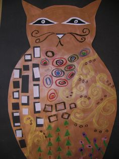"""We used gold paint to make the cat, cut it out, mounted it on black, and then used oil pastel and cut paper to make Klimt-inspired designs on our cat!"""