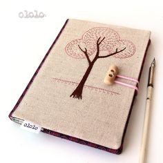 Hand emboidery.. Notebook cover of linen and cotton fabrics